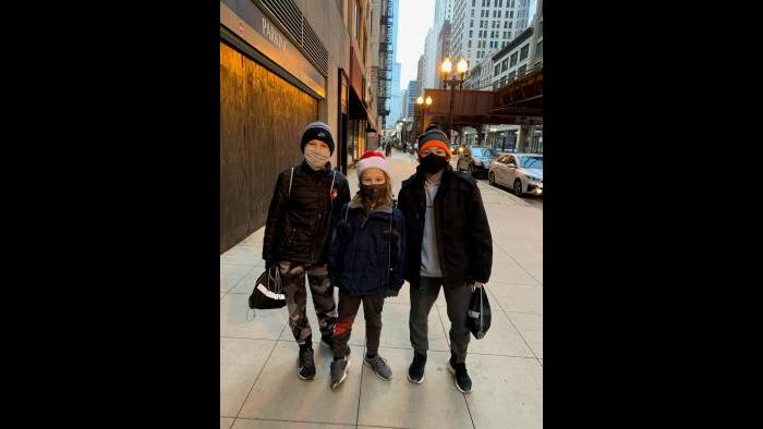 Children pose for a photo while delivering care packages in the South Loop on Saturday. (Photo: Monita Eng-Milton)