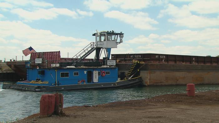 The tugboat Kimberly Selvick pushing a barge on the Calumet River.