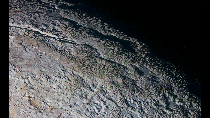 "Pluto's strange ""snakeskin"" mountain landscape (Courtesy NASA/JHUAPL/SWRI)"
