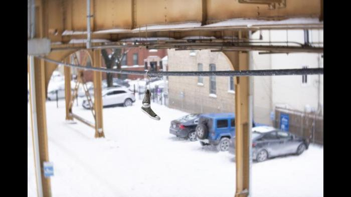 Hanging shoes on a wire under the snowy Paulina Brown Line (Submitted by Cody Corrall)