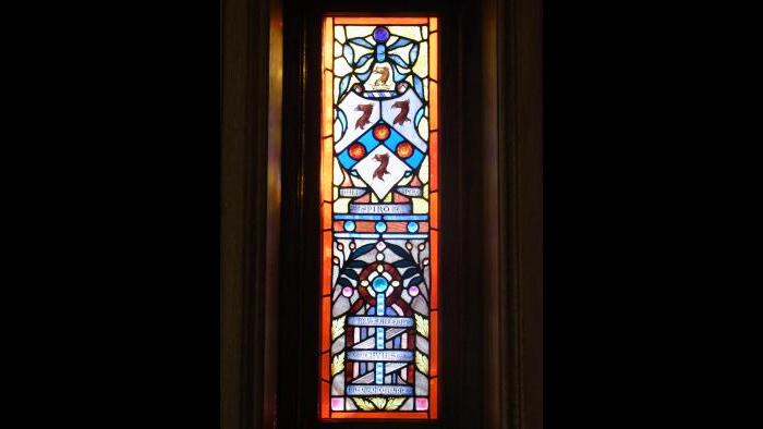 A stained glass window in the castle that has the Givins' family coat of arms. It is dedicated to his father, the Rev. Saltern Givins. (Credit: Michael Magidson)