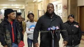 Martinez Sutton, center, speaks at City Hall on Thursday, Nov. 14, 2019 about the killing of his sister Rekia Boyd by former Chicago police Detective Dante Servin in 2012. (Matt Masterson / WTTW News)