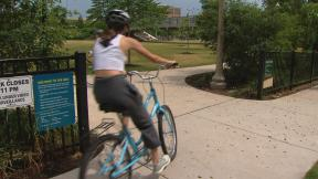 A cyclist enters the 606 trail in Chicago on its reopening date Monday, June 22, 2020. On Friday, the city and state will move into phase four of reopening plans. (WTTW News)