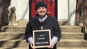 This March 26, 2018 photo provided by Ashley Atwater shows her mother, Sally Atwater, outside her home in the Georgetown area of Washington, a few days after leaving the hospital. (Courtesy Ashley Atwater via AP)
