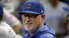In this Sept. 25, 2019, file photo, then-Chicago Cubs manager Joe Maddon stands in the dugout before a baseball game against the Pittsburgh Pirates, in Pittsburgh. (AP Photo / Gene J. Puskar, File)