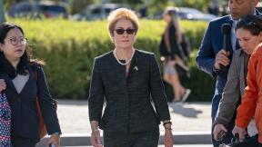 In this Oct. 11, 2019, file photo, former U.S. ambassador to Ukraine Marie Yovanovitch, center, arrives on Capitol Hill, Friday, Oct. 11, 2019, in Washington, to testify before congressional lawmakers as part of the House impeachment inquiry into President Donald Trump. (AP Photo / J. Scott Applewhite, File)