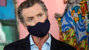 In this June 9, 2020, file photo, California Gov. Gavin Newsom wears a protective mask on his face while speaking to reporters at Miss Ollie's restaurant during the coronavirus outbreak in Oakland, Calif. (AP Photo / Jeff Chiu, Pool, File)