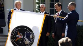 President Donald Trump watches with Vice President Mike Pence and Defense Secretary Mark Esper as the flag for U.S. Space Command is unfurled in the Rose Garden of the White House in Washington, D.C., on Thursday, Aug. 29, 2019. (AP Photo / Carolyn Kaster)