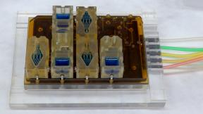 EVATAR is a female reproductive tract that fits in the palm of one's hand. Each divided compartment within the cube contains a 3-D model of a different part of the reproductive tract, such as the ovaries, fallopian tubes, uterus, cervix, vagina and liver. The blue fluid pumps through each compartment and performs the function of blood. (Courtesy of Northwestern Medicine)