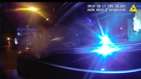 Body camera footage released Monday shows Chicago's former Police Superintendent Eddie Johnson, right, asleep behind the wheel of his vehicle on Oct. 17, 2019. The incident led to his eventual termination by Mayor Lori Lightfoot. (City of Chicago)