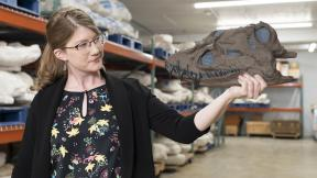 """Emily Graslie at the Museum of the Rockies in Bozeman, Montana, for Episode 2 of """"Prehistoric Road Trip."""" (Credit: Julie Florio / WTTW)"""