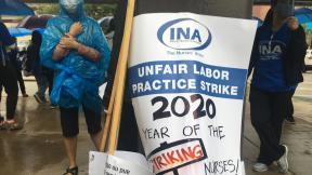 Nurses strike outside the University of Illinois Hospital on Saturday, Sept. 12, 2020, the first day of a planned seven-day strike. (Alma Campos / WTTW News)