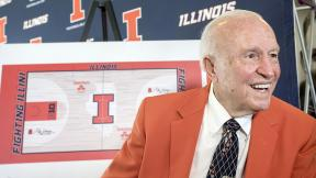 "In this Aug. 24, 2015, file photo, former Illinois men's basketball coach Lou Henson is interviewed during a ceremony announcing the naming of the basketball court at State Farm Center to ""Lou Henson Court"" at Memorial Stadium's 77 Club in Champaign, Ill. (Rick Danz / The News-Gazette via AP, File)"