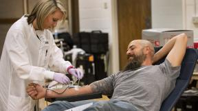American Red Cross collections staff member Cherrelle Simon collects a blood donation from Clint Kraft.  (Amanda Romney / American Red Cross)