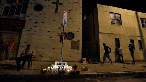 A makeshift memorial is set up, Wednesday, Sept. 2, 2020, in Rochester, N.Y., near the site where Daniel Prude was restrained by police officers. (AP Photo / Adrian Kraus)