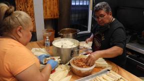 Claudio Velez makes pork tamales with his sister Maria in Velez's new restaurant Tamale Guy Chicago on Aug. 13, 2020. (Evan Garcia / WTTW News)