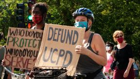 Activists in support of defunding the University of Chicago Police Department participate in a march on Saturday, Aug. 29, 2020. (Grace Del Vecchio / WTTW News)