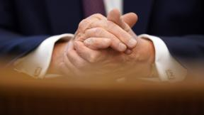 In this Sept. 11, 2020, file photo President Donald Trump clasps his hands as he speaks in the Oval Office of the White House in Washington. (AP Photo / Andrew Harnik, File)