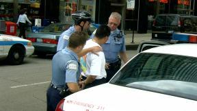 Chicago police make an arrest. (grendelkhan / Flickr)